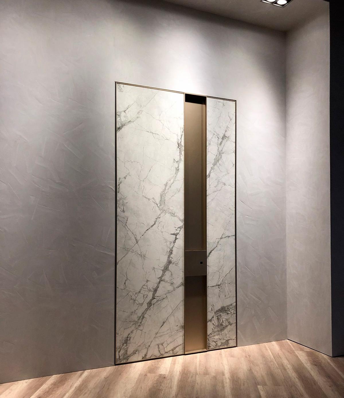 puerta blindada pivotante personalizable de Oikos